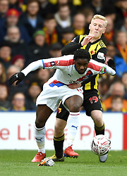 Crystal Palace's Jeffrey Schlupp (left) and Watford's Will Hughes battle for the ball