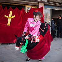 The religious performance uses traditional folk costumes and themes.