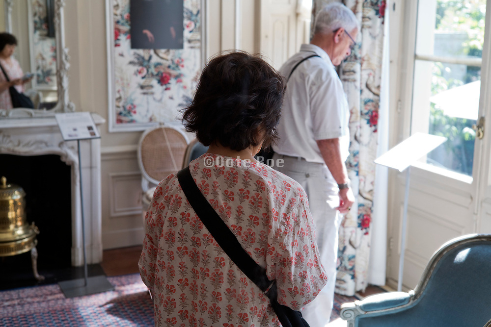 reading text at the historical Van Loon residential house Museum in Amsterdam