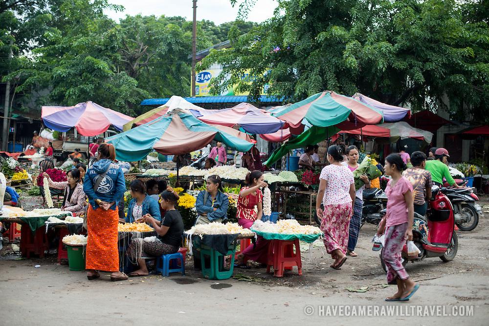 The afternoon flower street market in Mandalay, Myanmar (Burma).
