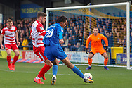 AFC Wimbledon defender Toby Sibbick (20) with a shot on goal during the EFL Sky Bet League 1 match between AFC Wimbledon and Doncaster Rovers at the Cherry Red Records Stadium, Kingston, England on 9 March 2019.