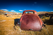 Rusted car and buildings, Bodie State Historic Park, California USA