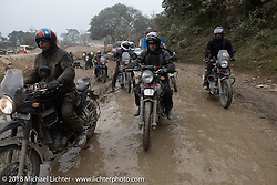Check out Dave Nolan crashing in the mud in the background behind Round the World Doug Wothke (L) and Kiwi Mike Tomas on day-9 of our Himalayan Heroes adventure riding from Pokhara to Nuwakot, Nepal. Wednesday, November 14, 2018. Photography ©2018 Michael Lichter.