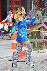 Rita Ora in a blue coat and over the knee boots she films a music video. 05 Oct 2017 Pictured: Rita Ora. Photo credit: STB / MEGA TheMegaAgency.com +1 888 505 6342