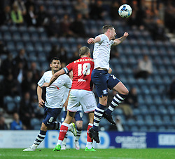 Aaron Wilbraham of Bristol City challenges for the header with Paul Huntington of Preston North End - Mandatory byline: Dougie Allward/JMP - 07966386802 - 15/09/2015 - FOOTBALL - Deepdale Stadium -Preston,England - Bristol City v Preston North End - Sky Bet Championship