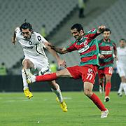 Karsiyakaspor's Fuat ERARSLAN (R) and Altayspor's Sehmus OZER (F) during their Play Off First leg match at Ataturk olympic Stadium in Istanbul Turkey on Monday, 17 May 2010. Photo by TURKPIX