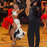 Yohei Goto and Tomomi Gamo of Japan perform their dance during the Professional Rising Stars Latin-american competition of the International Championships held in Brentwood International Centre, Brentwood, United Kingdom. Tuesday, 19. October 2010. ATTILA VOLGYI