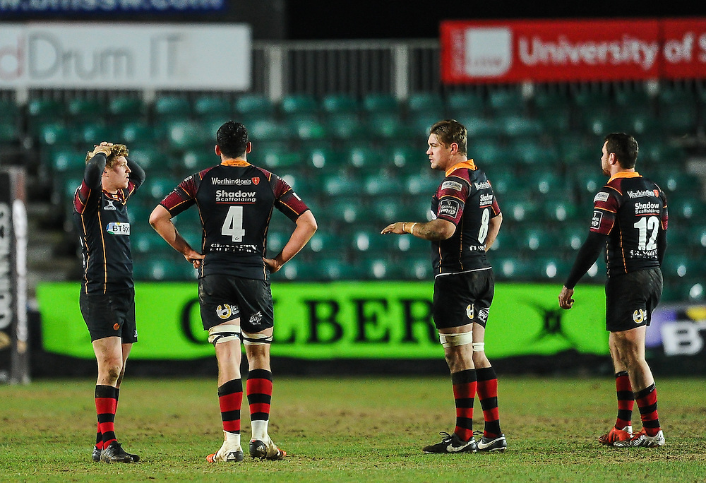 Dragons players dejected after the loss to Glasgow Warriors<br /> <br /> Photographer Craig Thomas/CameraSport<br /> <br /> Rugby Union - Guinness PRO12 Round 16 - Newport Gwent Dragons v Glasgow Warriors - Thursday 25th February 2016 - Rodney Parade - Newport<br /> <br /> © CameraSport - 43 Linden Ave. Countesthorpe. Leicester. England. LE8 5PG - Tel: +44 (0) 116 277 4147 - admin@camerasport.com - www.camerasport.com
