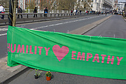 A banner with a Humility and Empathy message across Waterloo Bridge on day 4 of protests by climate change environmental activists with pressure group Extinction Rebellion, on18th April 2019, in London, England.