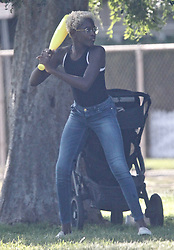 EXCLUSIVE: NBA superstar Dwyane Wade and Gabrielle Union spend the day at the park with daughters Zaya and Kaavia. The family spent the day at a Los Angeles park where they played horseshoes and baseball. Zaya hit a homer at one point and were later seen celebrating. Gabrielle Union also was seen with noticeably shorter hair for the outing. **SPECIAL INSTRUCTIONS*** Please pixelate children's faces before publication.***. 11 Jul 2020 Pictured: NBA superstar Dwyane Wade and Gabrielle Union spend the day at the park with daughters Zaya and Kaavia. Photo credit: ROMA / MEGA TheMegaAgency.com +1 888 505 6342