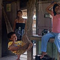 A Yanayacu Indian family relaxes in their hut in San Juan de Yanayacu village in Peru's Amazon Jungle.