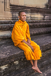 Aug. 2, 2013 - Young Buddhist monk sitting at temple in Angkor Wat, Siem Reap, Cambodia (Credit Image: © Gary  Latham/Cultura/ZUMAPRESS.com)