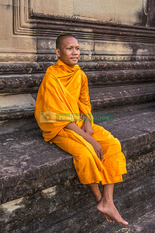 Aug. 2, 2013 - Young Buddhist monk sitting at temple in Angkor Wat, Siem Reap, Cambodia (Credit Image: © Gary  Latham/Cultura/ZUMAPRESS.com)