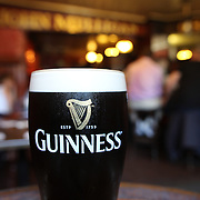 A pint of Guinness at Mulligans Pub, Poolbeg Street, Dublin. The pub is two minutes walk from the main thoroughfare, O'Connell Street and has been at the core of the city's cultural and imbibing life for nearly 300 years. Originally a shebeen (unlicensed drinking venue) it has been 'legal' since 1782, making it one of the oldest premises in Ireland's metropolis. Dublin, Ireland. Photo Tim Clayton