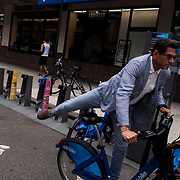 A man rides hops on a Citi Bike along 8th Avenue crossing West 26th Street where Dan Hanegby was killed in New York., NY, Friday, June 16, 2017. Dan Hanegby, A 36-year-old investment banker was killed in Manhattan on Monday morning when the Citi Bike he was riding collided with a charter bus, the first fatality involving New York City's four-year-old bike-share program. John Taggart for The New York Times.