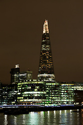 © Licensed to London News Pictures. 19/03/2016. London, UK. The Shard in London seen with the lights on, shortly before Earth Hour 2016. Landmarks around the world are switching their lights off for Earth Hour this evening, a global switch-off event aimed at protecting the planet and highlighting the effects of climate change. This year marks the 10th annual Earth Hour. Photo credit : Vickie Flores/LNP