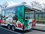 D'Angelo's Italian sausage food trailer on Woodhaven Blvd in Queens. The trailer is from a company that builds trailers for race cars, and the rear ramp has been swapped for a solid back with a window, and a door has been added to the front of the trailer. The customization as a food trailer was by 800BuyCart.
