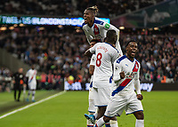 Football - 2019 / 2020 Premier League - West Ham United vs. Crystal Palace <br /> <br /> Crystal Palace players celebrate after VAR allows them the winning goal at the London Stadium<br /> <br /> COLORSPORT/DANIEL BEARHAM