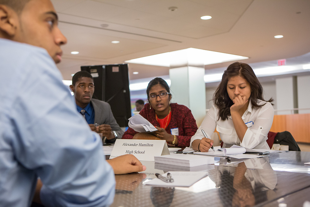 Purchase, NY – 31 October 2014. Sarin Sajan Itty, center, from the Alexander Hamilton High School team, discussing a point about the case. Alexander Hamilton High School placed third in the 2014 competition. The Business Skills Olympics was founded by the African American Men of Westchester, is sponsored and facilitated by Morgan Stanley, and is open to high school teams in Westchester County.