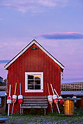 A red fish house against the fading light during sunset at Orrs Island, Maine.