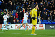 West Ham's Mark Noble ® celebrates after he scores his sides 2nd goal. Barclays Premier league, Cardiff city v West Ham Utd match at the Cardiff city Stadium in Cardiff, South Wales on Saturday 11th Jan 2014.<br /> pic by Andrew Orchard, Andrew Orchard sports photography.