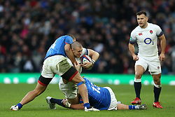 England's Mike Brown is tackled by Samoa's Paul Perez (left) and Kiefron Fonotia (right) during the Autumn International at Twickenham Stadium, London.