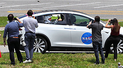 SpaceX Crew Dragon astronauts Doug Hurley and Bob Behnken wave to supporters as they are driven to the launch complex at Kennedy Space Center, Fla., ahead of launch on Saturday, May 30, 2020. The SpaceX Demo-2 mission is the first crewed launch of an orbital spaceflight from the U.S. in nearly a decade. Photo by Joe Burbank/Orlando Sentinel/TNS/ABACAPRESS.COM