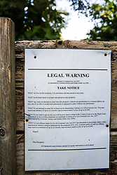 Sipson, UK. 5th June, 2018. A warning notice is pictured at Grow Heathrow. Grow Heathrow is a squatted off-grid eco-community garden founded in 2010 on a previously derelict site close to Heathrow airport to rally support against government plans for a third runway and it has since made a significant educational and spiritual contribution to life in the Heathrow villages, which remain threatened by Heathrow airport expansion.