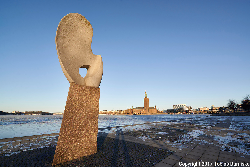 The Solbåten sculpture on Riddarholmen, a small island in Stockholm. One has a panoramic view of the bay Riddarfjärden, with the Stockholm City Hall in the background.