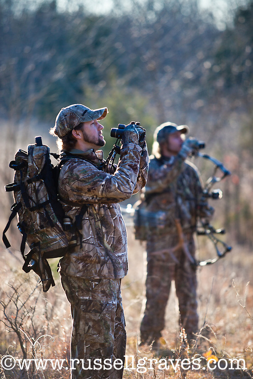 Bowhunters glassing for game