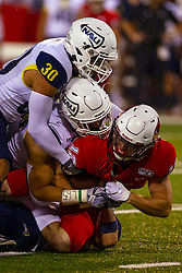 NORMAL, IL - September 21: Taylor Grimes is stopped by a pair of Lumberjacks during a college football game between the ISU (Illinois State University) Redbirds and the Northern Arizona University (NAU) Lumberjacks on September 21 2019 at Hancock Stadium in Normal, IL. (Photo by Alan Look)