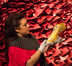 "Sotheby's, London, January 14th 2016. Paper artist ZOE BRADLEY exhibits spectacular paper sculptures inspired by the fashion in old master paintings. Her astonishing works are exhibited alongside 460 royal and aristocratic heirlooms  that will appear in Sotheby's ""Of Royal and Noble Descent"" auction to be held between 14th and 18th January. PICTURED: Paper sculptor Zoe Bradley displays her gold shoes with Swarovski crystal detailing. ///FOR LICENCING CONTACT: paul@pauldaveycreative.co.uk TEL:+44 (0) 7966 016 296 or +44 (0) 20 8969 6875. ©2015 Paul R Davey. All rights reserved. displays her shoes with Swarovski crystal details. ///FOR LICENCING CONTACT: paul@pauldaveycreative.co.uk TEL:+44 (0) 7966 016 296 or +44 (0) 20 8969 6875. ©2015 Paul R Davey. All rights reserved."