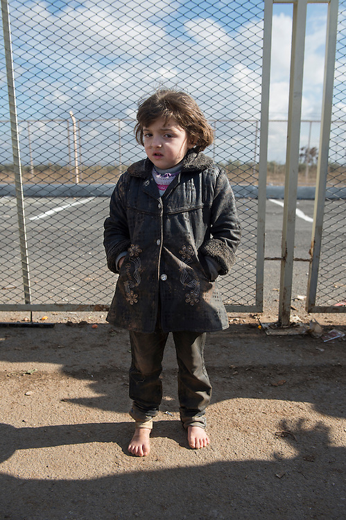 Syrian - Turkish border in Kilis, newly arrived refugee from Aleppo who had to escape Turkish border controls and cross the border illegally.  Because Turkey is saturated with refugees, they will likely get no  help, no work, and no place in a refugee camp. Many refugees return to Aleppo after a few month in Turkey, a country that is now saturated with refugees.