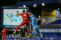 Birmingham City's Marc Roberts, Leo Ostigard and Maxime Biamou of Coventry City compete in the air, in front of a big screen showing the score as 0-0 - Mandatory by-line: Nick Browning/JMP - 20/11/2020 - FOOTBALL - St Andrews - Birmingham, England - Coventry City v Birmingham City - Sky Bet Championship