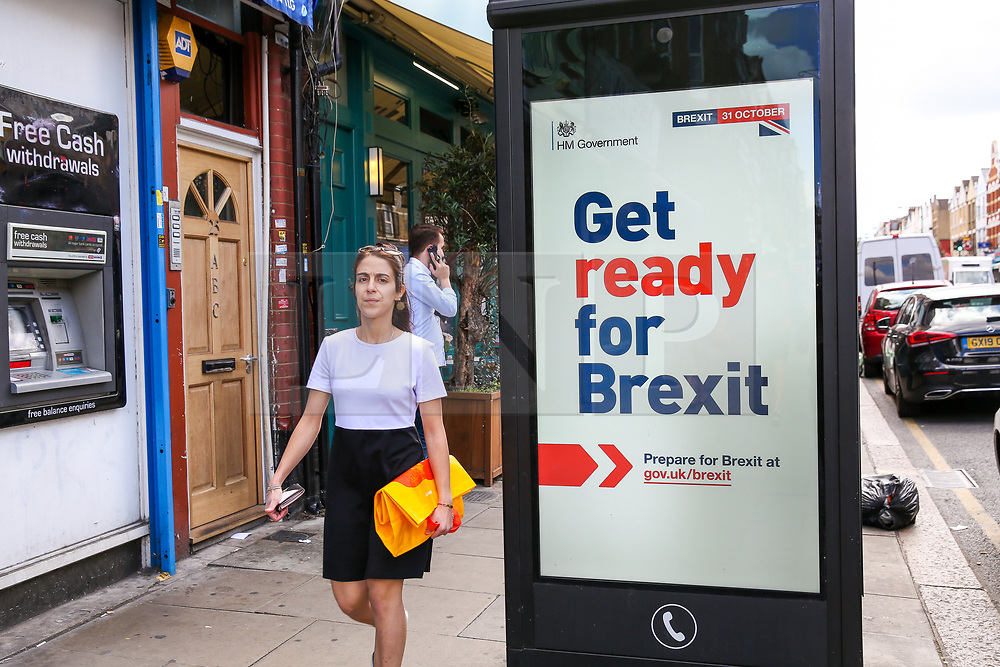 """© Licensed to London News Pictures. 01/09/2019. London, UK. A woman walks past the new """"Get ready for Brexit"""" advert on a telephone box in north London. <br /> Today, the UK Government launches its £100m """"Prepare for Brexit"""" advertising campaign to reassure the nation ahead of a potential no-deal departure from the European Union on 31 October.Photo credit: Dinendra Haria/LNP"""