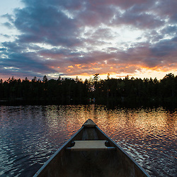 The bow of a canoe on Lang Pond in Maine's Northern Forest. Cold Stream watershed, Parlin Pond Township.