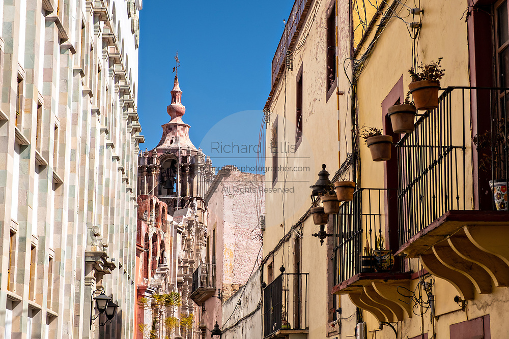View of the bell tower of the Templo de la Compania in the historic center of Guanajuato City, Guanajuato, Mexico. The massive Churrigueresque styled church is the religious center for the Jesuit order in the capital.