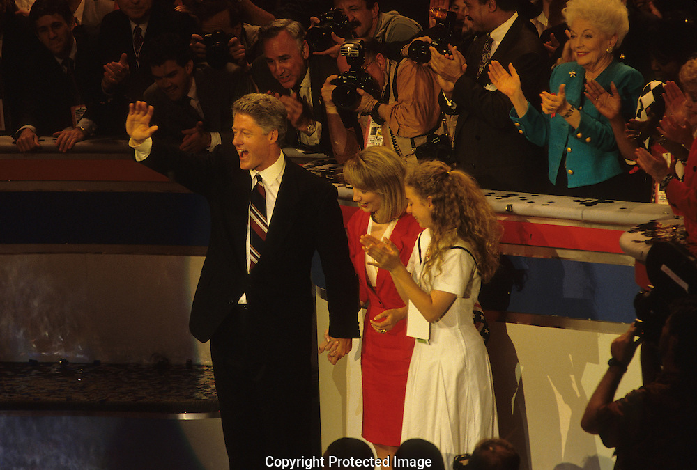 Bill , Hillary Rodham, and Chelsea Clinton at the women's caucus rally at the Democratic Convention in 1992..Photograph by Dennis Brack bb24