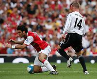 Photo: Steve Bond.<br />Arsenal v Derby County. The FA Barclays Premiership. 22/09/2007. Kenny Miller (R) fouls Cesc Fabrigas