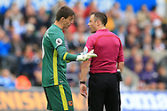 referee Stuart Attwell has words with Eldin Jakupovic , the Hull city goalkeeper. Premier league match, Swansea city v Hull city at the Liberty Stadium in Swansea, South Wales on Saturday 20th August 2016.<br /> pic by Andrew Orchard, Andrew Orchard sports photography.
