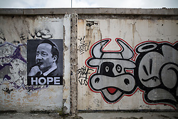 """© Licensed to London News Pictures . 23/05/2015 . Manchester , UK . A poster featuring an image of David Cameron pointing a gun in to his mouth , with the caption """" HOPE """" , pasted on a graffiti covered wall in a car park in central Manchester . Photo credit : Joel Goodman/LNP"""
