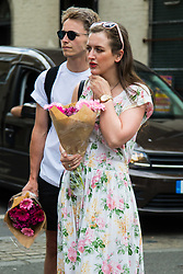 London, June 4th 2017. XA couple arrive with flowers at Borough High Street during a massive policing operation in the aftermath of the terror attack on London Bridge and Borough Market on the night of June 3rd which left seven people dead and dozens injured