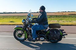 Carl Olsen of Carl's Cycle in Aberdeen riding his 1936 EL Harley-Davidson Knucklehead for the USS South Dakota submarine flag relay across South Dakota. Groton, SD. USA. Sunday October 8, 2017. Photography ©2017 Michael Lichter.