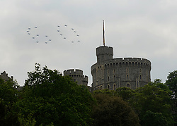 © Licensed to London News Pictures. 19/05/2012. WIndsor, UK 20 Tucanos fly over Windsor Castle in the formation of a Sixty to celebrate the Jubilee year. Armed Forces muster and parade in Windsor today , 19th May 2012, in tribute to Her Majesty the Queen for the Diamond Jubilee. 2,500 troops paraded through the town before the Queen and Duke of Edinburgh to mark the Diamond Jubilee. Once the parade has passed the Queen and Duke traveled along the same route to an arena within Home Park, where the troops mustered. A tri-service flypast of 78 aircraft, including helicopters, Hawks, the Battle of Britain Memorial Flight, the Red Arrows and Tornados went overhead. Photo credit : Stephen Simpson/LNP