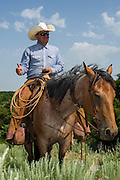 Rylan White stops to provide a history lesson to riding guests at Island Ranch.