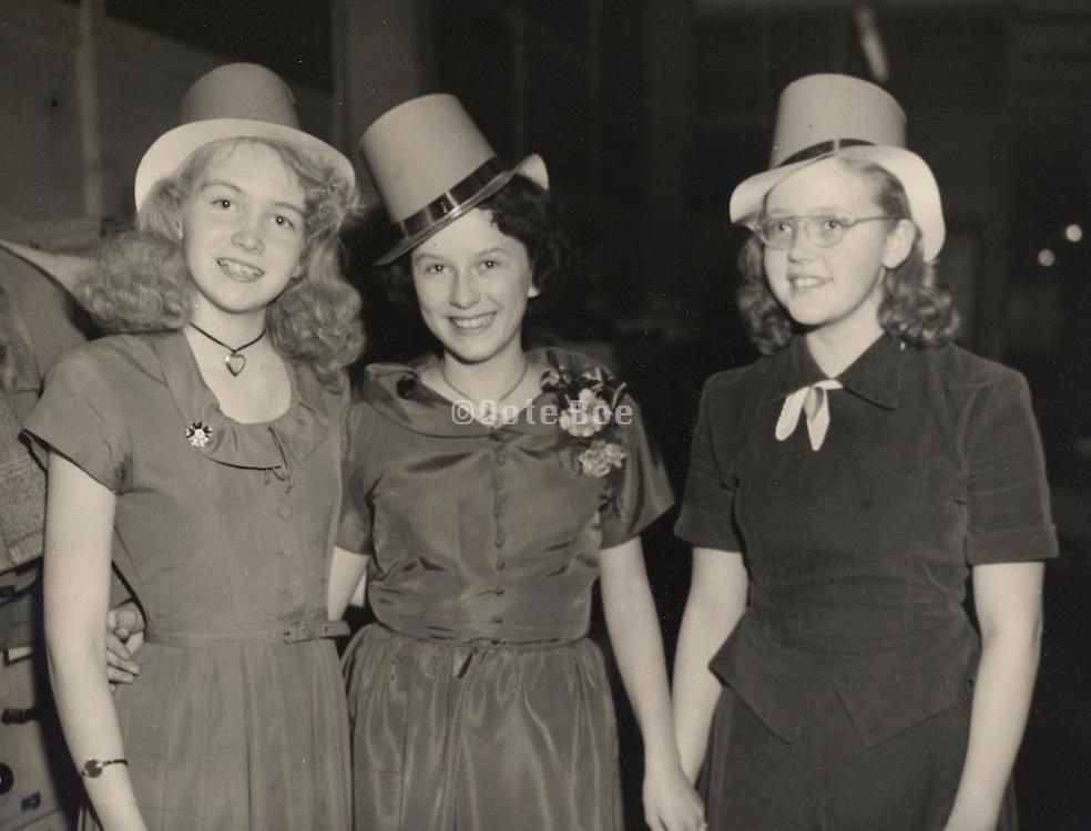 Three girls having fun at a party 1948.
