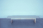 a blurry wooden bench
