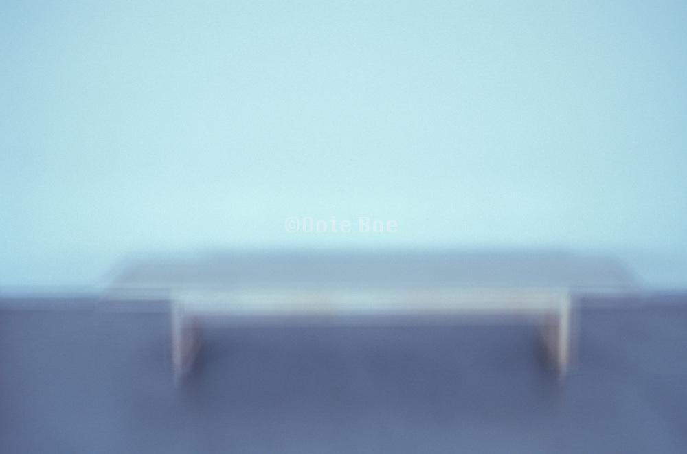 a blurry wooden bench
