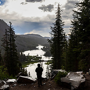A late afternoon thunderstorm drops rain and darkens the sky over the Twin Lakes in Mammoth, California.