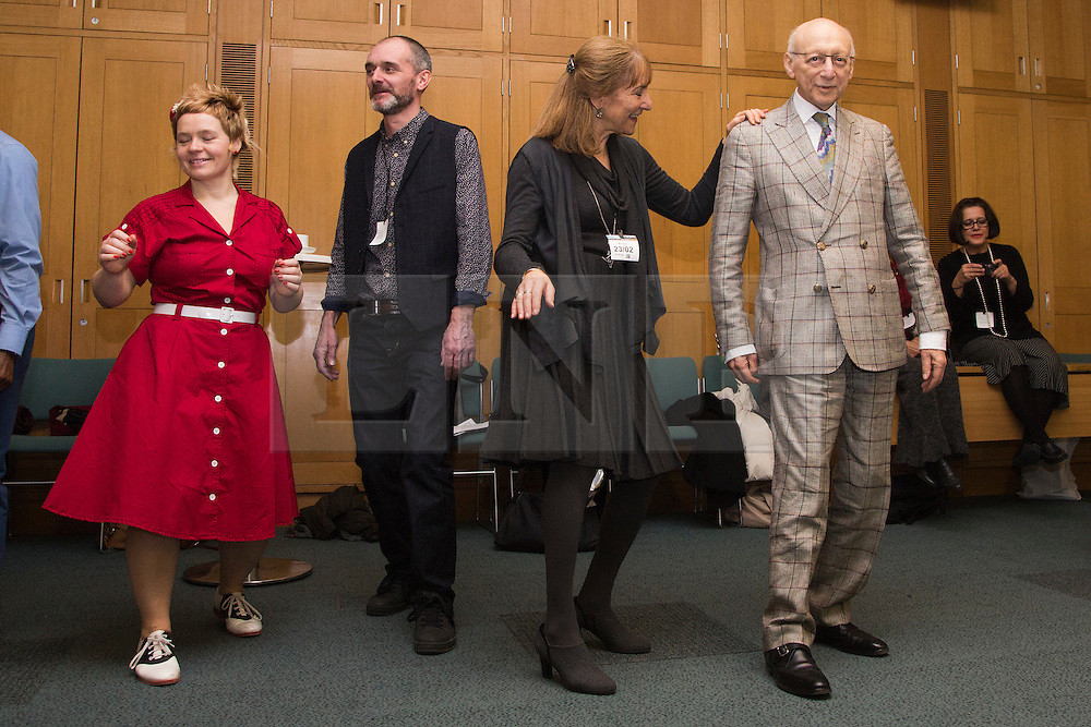 © Licensed to London News Pictures. 23/02/2015. London, England. Sir Gerald Kaufman, Chair of the All Party Dance Group, dances with members of Dance UK.  MPs attend a dance class with members of Dance UK and Lindy Hop dancers. Dance UK launches the 2015 Dance Manifesto with a beginners' social dance class hosted by the All Party Parliamentary Dance Group for all MPs at Portcullis House and led by teacher Jenny Thomas, charleston choreographer for the BBC's Strictly Come Dancing with Strictly professional dancer Robin Windsor. Photo credit: Bettina Strenske/LNP